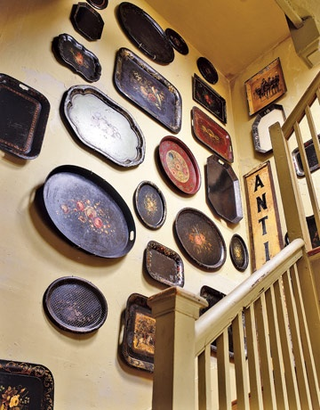 Elizabeth Stetson's collection of Tole Trays (via Country Living  - Decorating With Quirky Antiques)